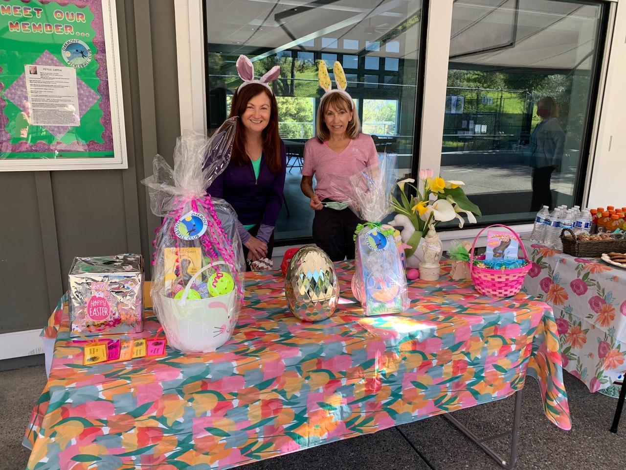Credit: Photo by Helen Selenati Social committee volunteer Liz Majkowski and Carol Palombino posing with the Easter raffle prizes.