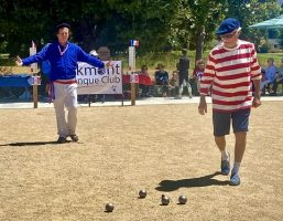 Jean-michel Poulnot and Jim Knapp throwing boules on Bastille Day. (photo by Julie Kiil)  PUBLISHER NOTE: Julie can supply higher pixel image if required
