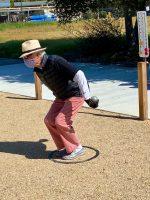 Jim Knapp prepares to shoot a point-scoring opponent's boule.