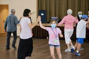 Square dancing during Grandparents' Week, 2021